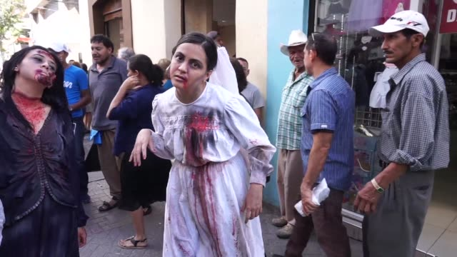 Some 400 people dressed as zombies hold a protest in Tegucigalpa Honduras asking the population to vote with their conscience and not like zombies in...