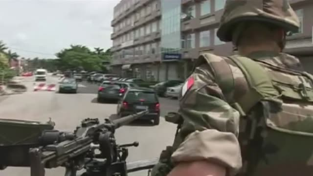 some 500 foreigners sought refuge in a french military camp in ivory coast's main city abidjan amid fighting between incumbent laurent gbagbo and his... - 50 seconds or greater stock videos & royalty-free footage