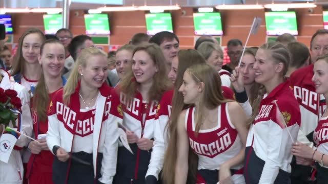 vídeos de stock, filmes e b-roll de some 70 russian competitors from the country's depleted olympics team fly out from moscow for rio aftere sports federations whittled down the number... - rio russian