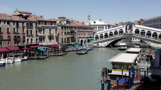 MS Some boats and gondolas flowing below bridge / Venice, Veneto, Italy