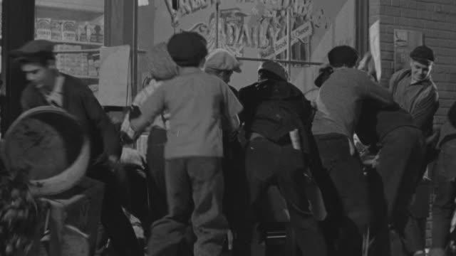 vidéos et rushes de  ms some boys take destroy vegetables in front of store - agression