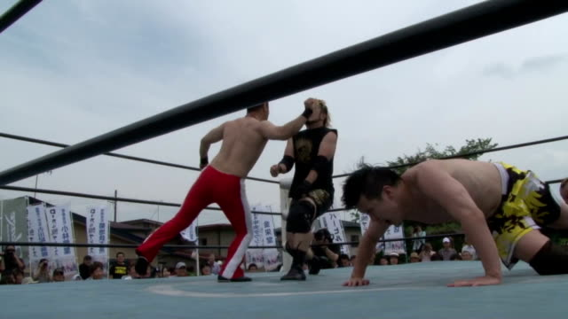 some fifty fans cheered and screamed at a rare live professional wrestling match aboard a local train in japan the fortyminute matchup between akayu... - yamagata prefecture stock videos & royalty-free footage