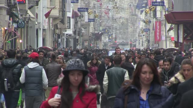 stockvideo's en b-roll-footage met some of istanbul's residents speculate that turkey's location on the frontier between europe, asia and the middle east has helped fanned high-level... - benen gespreid