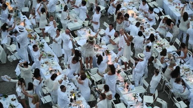 Some of the 5000 guests arriving all dressed in white during 'Le Diner en Blanc Sydney' on Cockatoo Island on November 19 2016 in Sydney Australia...