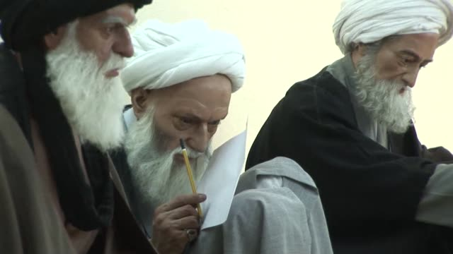 stockvideo's en b-roll-footage met some of the most famed shiite clerics of modern times have gathered together in a modest room under a religious school in najaf in central iraq as... - najaf
