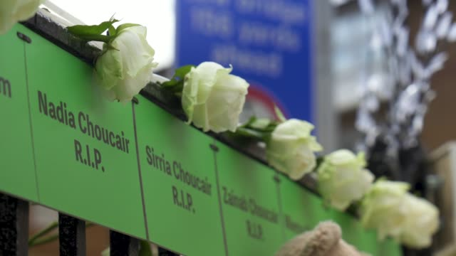 some of the names of the dead are on fences close to grenfell tower in west london on june 14 on the third anniversary of the highrise fire that... - identity stock videos & royalty-free footage