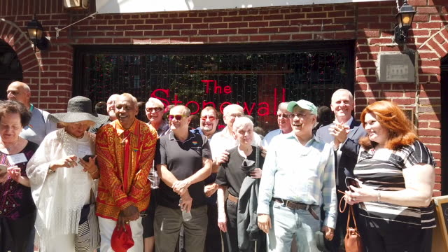some of the people who were at the stonewall inn the night the historic gay bar was raided by police on june 28, 1969 gather for a photo shoot in... - single father stock videos & royalty-free footage