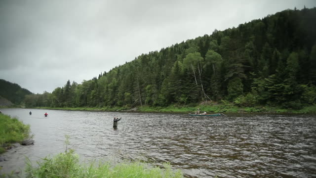 Some people are fishing in the river