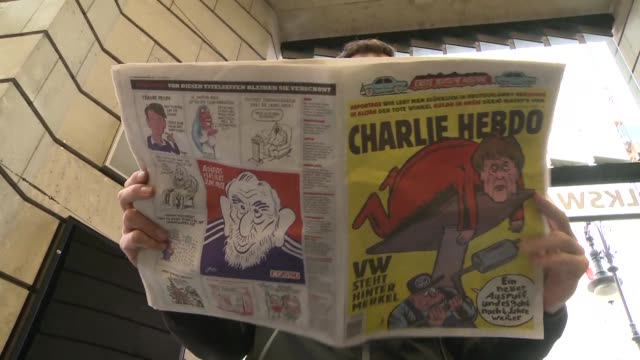 stockvideo's en b-roll-footage met some put chancellor angela merkel on a pedestal but french satirical weekly charlie hebdo places her on a toilet seat as it tries to conquer germany... - satire