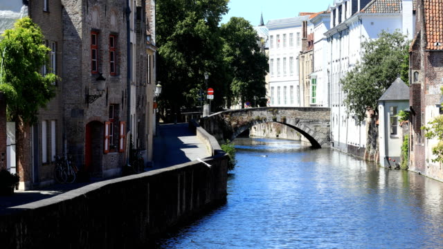 some rare tourists visit the medieval citiy of bruges on may 31, 2020. bruges played an important role in the middle ages, a period during which the... - tourism stock videos & royalty-free footage