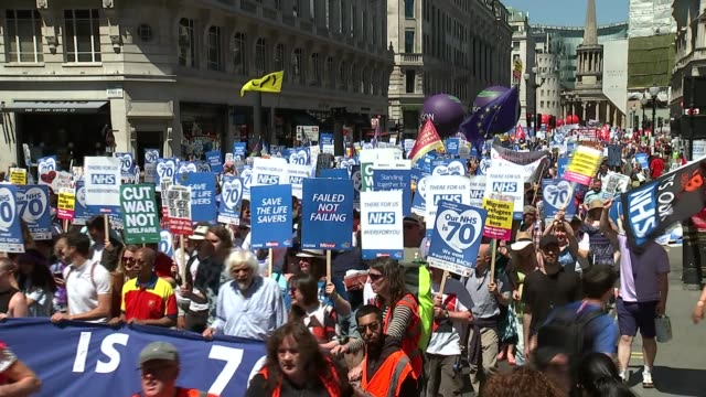 Some routine NHS procedures to be restricted in efficiency savings UK London NHS 70th anniversary march Unite balloon Julie Hesmondhalgh interview...