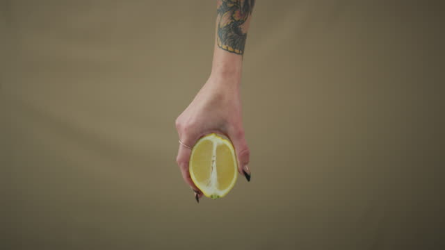 some see a lemon, i see lemonade - brown background stock videos and b-roll footage
