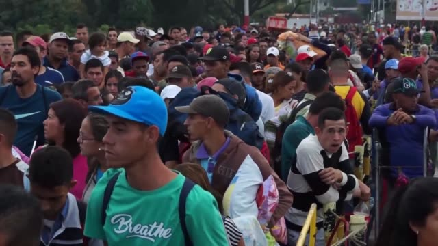 some seek food and medicine others don't plan to return thousands of venezuelans pass through the border into colombia in defiance of new immigration... - venezuela stock videos & royalty-free footage