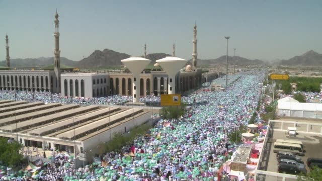 some two million muslims streamed into mina valley from the holy city of mecca on the annual hajj pilgrimage sunday clean crowds gather for prayer... - hajj stock videos & royalty-free footage