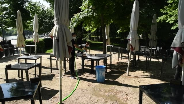 some workers clean and prepare the tables on the galapagos terrace in parque del retiro after 72 days closed due to the coronavirus crisis on may 25... - galapagos islands stock videos & royalty-free footage