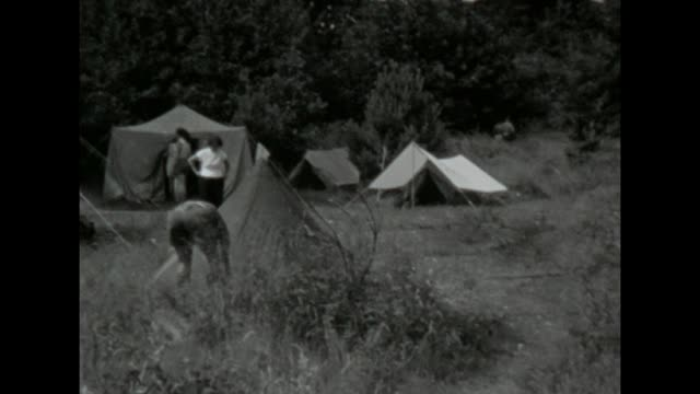 some young friends do camping by a lake near salem / shot in 1957 - 1957 stock videos & royalty-free footage