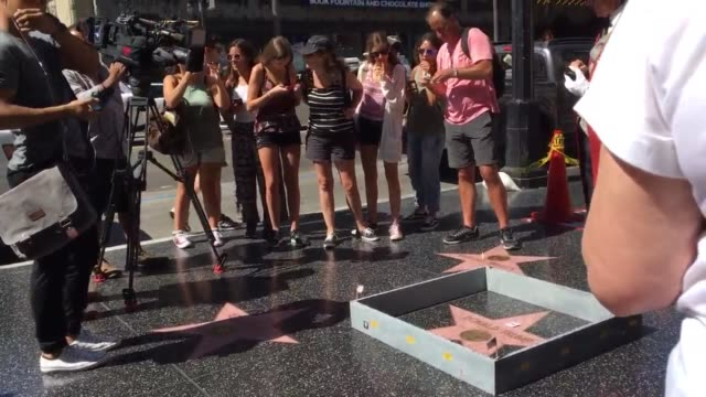 Someone constructed a wall around Donald Trump 's star on the Hollywood walk of fame
