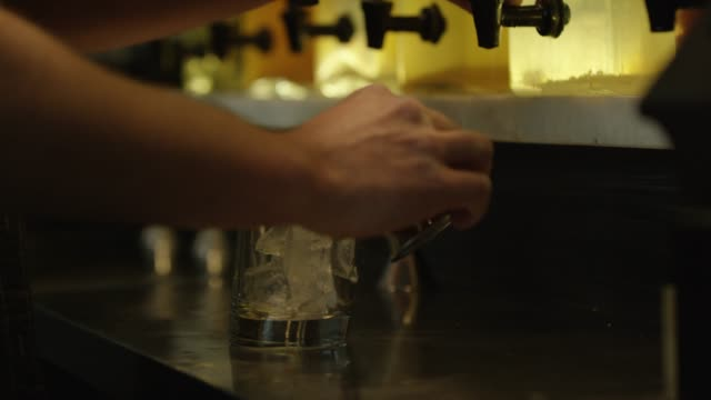 someone pours a shot into a glass - tonic water stock videos & royalty-free footage