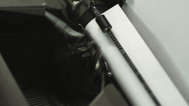 someone typing on an old-fashioned typewriter - menschlicher finger stock-videos und b-roll-filmmaterial