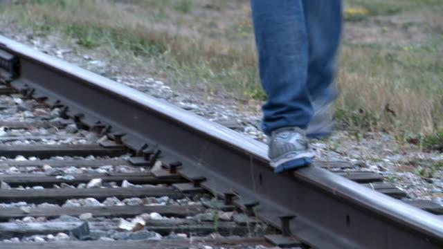Someone walks on a railway