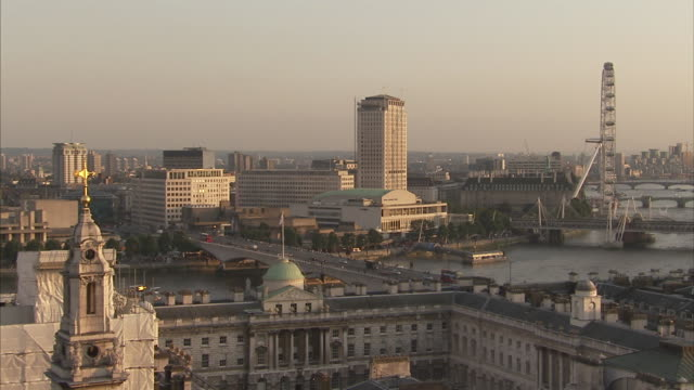 somerset house in foreground with traffic on waterloo bridge royal festival hall and millennium wheel in the background london available in hd. - the strand london stock videos and b-roll footage