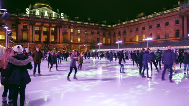 somerset house xmas ice rink - ice skating stock videos and b-roll footage