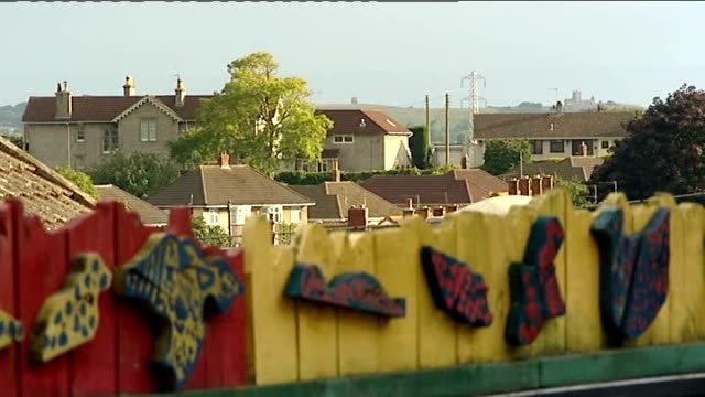 somerset primary school teacher admits sexual abuse of pupils general view of hillside first school and sign rooftops of houses beyond school fence... - 女性教師点の映像素材/bロール