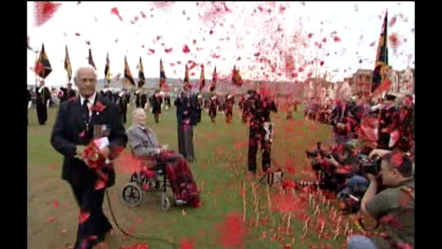 weston super mare 109yearold harry patch sitting in wheelchair at photocall as poppies fall around him - weston super mare stock videos and b-roll footage