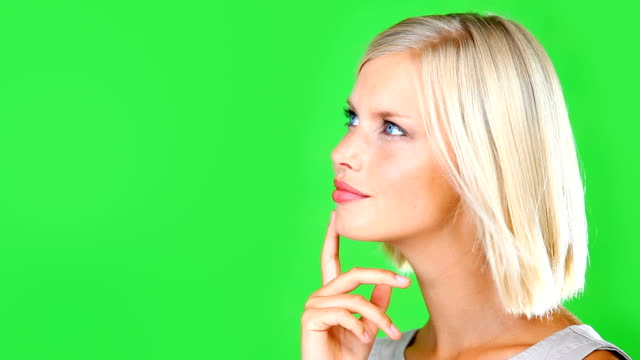 something has her attention! - green background stock videos and b-roll footage