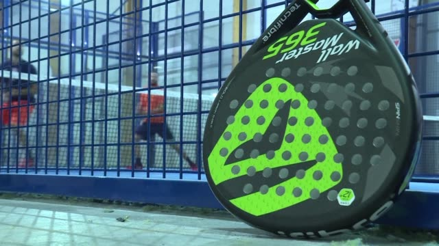 somewhere between tennis and squash is padel a racket sport played across spain - squash sport stock videos & royalty-free footage