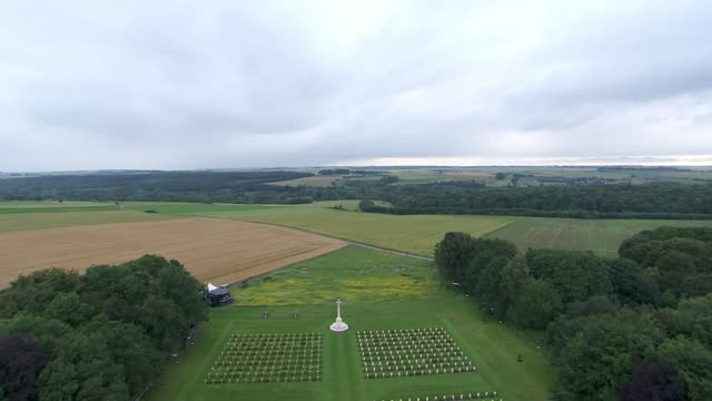 Duke and Duchess of Cambridge and Prince Harry receive briefing on top of Thiepval monument FRANCE Thiepval Memorial EXT Union flag / fields /...