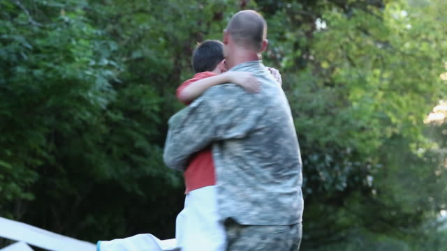 ws td son and dog greeting soldier returning home from miliatry service / richmond, virginia, united states - war veteran stock videos & royalty-free footage