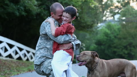 ws son and dog greeting soldier returning home from miliatry service / richmond, virginia, united states - homecoming stock videos & royalty-free footage