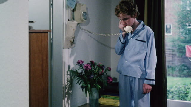 montage son answering a phone call for his father and worker describing an emergency to the mine manager / united kingdom - antworten stock-videos und b-roll-filmmaterial