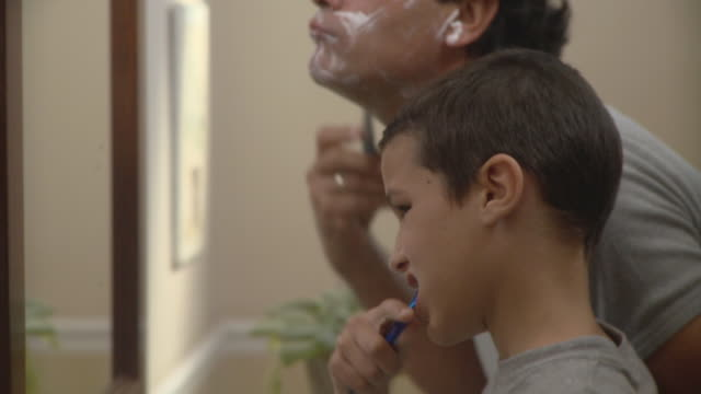 cu son (10-11) brushing while father shaving in bathroom / havana, cuba - shaved stock videos & royalty-free footage
