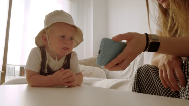 son dancing watching his mother's mobile phone - small stock videos & royalty-free footage