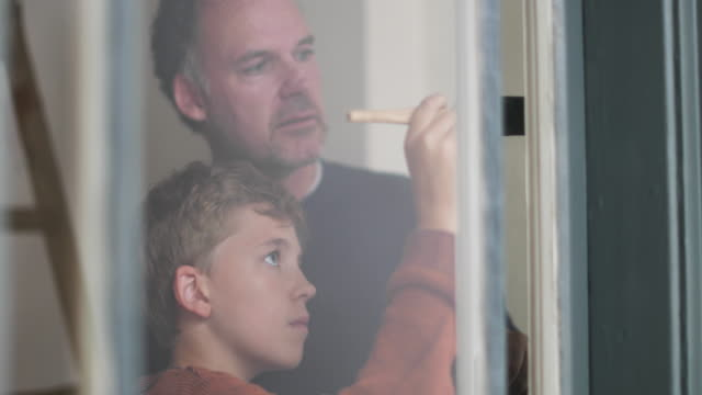 Son helping Father to decorate