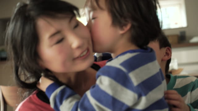 son is a kiss to mother - japanese mom stock videos & royalty-free footage