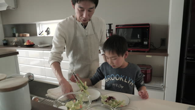 son is serve the salad together the father - single father stock videos & royalty-free footage