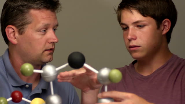 son shows father his science project of a molecule - representing stock videos & royalty-free footage