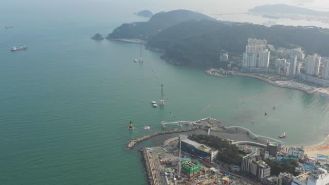 vídeos de stock, filmes e b-roll de songdo skywalk and songdo marine cable car in songdo beach / seo-gu, busan, south korea - cable