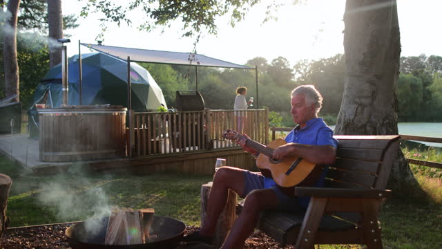 songs by the campfire - non urban scene stock videos & royalty-free footage