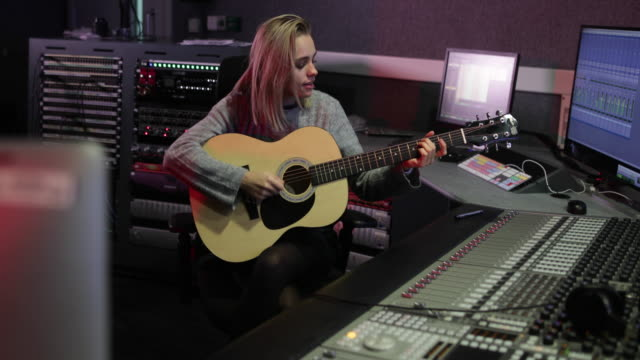 Songwriter in a music recording studio