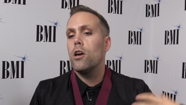 songwriters collecting prizes at the bmi pop awards speak of the influence icon honouree barry manilow had on them. justin tranter speaks of the... - バリー・マニロウ点の映像素材/bロール