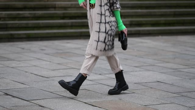 sonia lyson is seen wearing black boots zara cuffed creme white pants green longsleeve hm max mara cardigan dior belt black clutch bottega veneta... - cardigan sweater stock videos & royalty-free footage