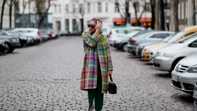 sonia lyson is seen wearing dior sunglasses, multi colored sneaker sandro, green corduroy pants, isabel marant, black glitter turtleneck zara, multi... - escada stock videos & royalty-free footage