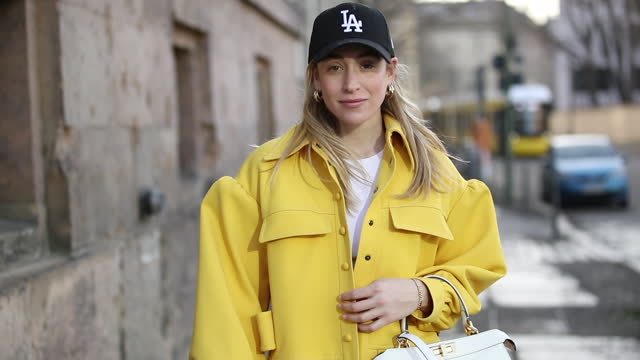 sonia lyson is seen wearing fendi: yellow coat, black pants, boots, white shirt, white bag and new era cap on february 24, 2021 in berlin, germany. - yellow stock videos & royalty-free footage