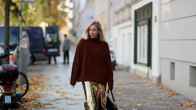 Sonia Lyson is seen wearing leopard pumps Zara golden glitter pencil skirt with slit other stories brown oversized turtleneck other stories black...