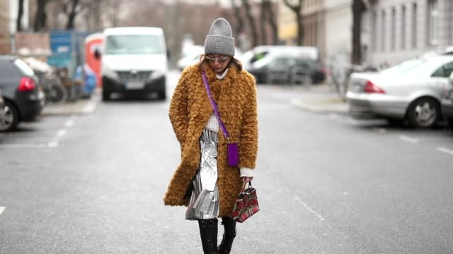 sonia lyson is seen wearing mustard baum und pferdgarten teddy coat, silver zara skirt, topshop sweater, prada sunglasses, fendi bag during the... - jumper stock videos & royalty-free footage