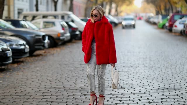 Sonia Lyson is seen wearing red velvet sandals Mai Piu senza cropped snake print jeans turtleneck Zara red Ducie fake fur jacket Dior saddle bag Miu...